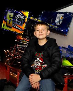 Dash Osmer, 12, with his Christmas light decorated Micro-Sprint race car. Seb Foltz/Butler Eagle 12/15/20