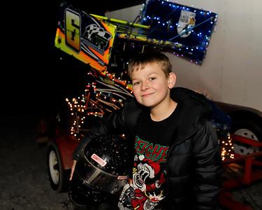 Dash Osmer, 12, with his Christmas light decorated Micro-Sprint racecar. Seb Foltz/Butler Eagle 12/15/20