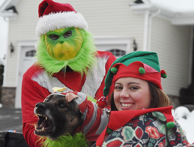 The Grinch that stole Christmas and Santa made a surpirse visit to the residents of Weatherburn Heights in Valencia compliments of the Middlesex Twp. fire, police and municipailty Friday afternoon December 18, 2020. Harold Aughton/Butler Eagle