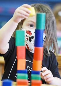 Kellen Toner, 3, a preschooler at Butler Montessori plays with building blocks during class Tuesday, December 15, 2020. Harold Aughton/Butler Eagle.