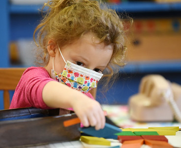Cassidy Fagan, a pre-schooler at Butler Montessori, plays with colored blocks during class Tuesday morning, December 15, 2020.