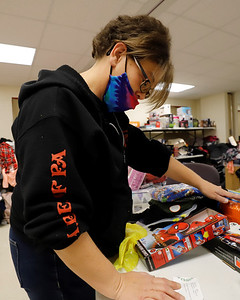 Butler Salvation Army's Amy Tebay picks toys for a family in need as part of the organizations Christmas toy drive. Seb Foltz/Butler Eagle 12/19/20