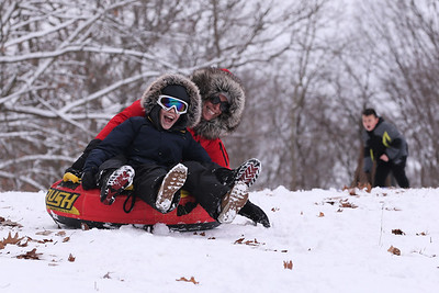 Jamie Thompson and her daughter Molly, 10, of Harmony sled down the sledding hill on Moraine State Park's South Shore Thursday. Seb Foltz/Butler 12/17/20