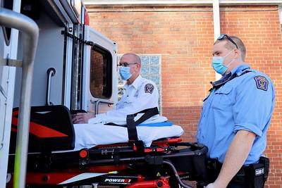 Butler Ambulance director of operations Gene Troyan (left) and advanced EMT Adam Sutton load a gurney into an ambulance Tuesday. Seb Foltz/Butler Eagle Dec. 23 2020