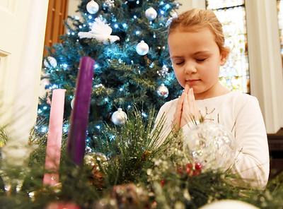 Preschooler Piper Shockey, 6, of Butler Township says a prayer following the Butler Montessori School's Christmas program at the Covenant Presbyterian Church in Butler Monday, December 21, 200. Harold Aughton/Butler Eagle.