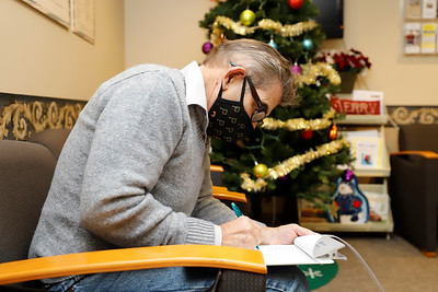 A patient fills out paperwork at the Jean B Purvis Community Health Center Friday. Seb Foltz/Butler Eagle 12/18/20