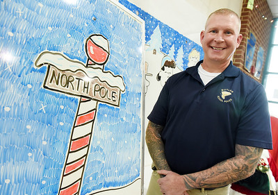 Jim Green, security guard at Center Township Elementary, has been creating holiday art on the school's whiteboards for students. Harold Aughton/Butler Eagle.  Harold Aughton/Butler Eagle.
