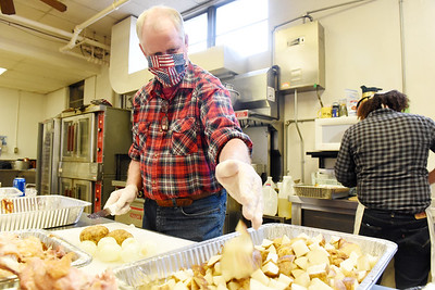 Gil Gilson of Portersville, helped prep for the 49th Christmas dinner at the First United Methodist Church in Butler, Wednesday afternoon, December 23, 2020. In preparation to serve 700 meals, volunteers cooked 68 turkeys, peeled 190 lbs. of potatoes and 100 lbs. of carrots. Harold Aughton/Butler Eagle.