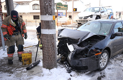 Two vehicle accident Sunday at intersection of W. Jefferson and S. Chestnut streets. Both vehicles came to a stop next to each other with one striking a utility pole. Seb Foltz/Butler Eagle 12/27/20
