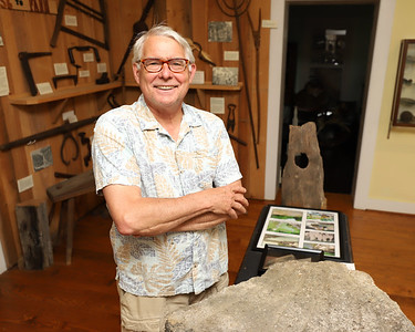 Historic Harmony president Rodney Gasch stands by an old mill stone from the old Harmony area mill. Seb Foltz/Butler Eagle  (June 2020)