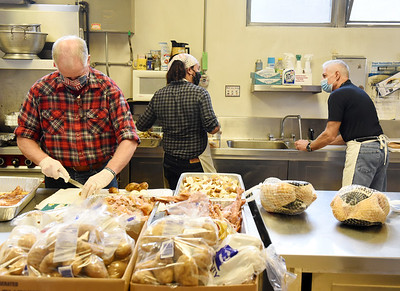 Gil Gilson, left, Phillip Sweatt and Tim Evanoff helped prep for the 49th Christmas dinner at the First United Methodist Church in Butler, Wednesday afternoon, December 23, 2020. In preparation to serve 700 meals, volunteers cooked 68 turkeys, peeled 190 lbs. of potatoes and 100 lbs. of carrots. Harold Aughton/Butler Eagle.