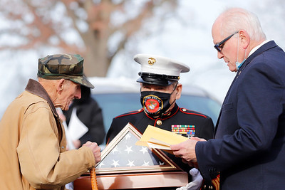 World War II veteran Karl Herold recieves a commemorative flag from Marine Corps Leaue Sgt. Major Sam Zurzolo with U.S. Rep. Mike Kelly(left) during a ceremony celebrating Herold's 100th birthday.