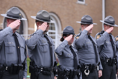 State troopers from salute the fallen officer memorial at the Butler barracks of the Pennsylvania State Police Saturday during a wreath laying ceremony with the Enforcers Motorcycle Club.Seb Foltz/Butler Eagle 12/05/20