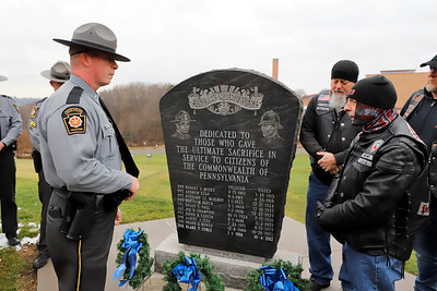 Pennsylvania State Trooper Kittaning station commander Eric Simko talks with Enforcer Motorcycle club member 'URGENT' (only name given) following Saturday's wreath laying at the Butler barracks. Seb Foltz/Butler Eagle