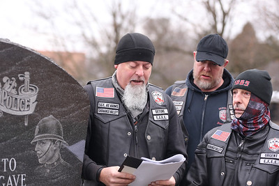 Mark 'Detune' Hensel of the Enforcers Motorcycle Club honors fallen state troopers during a ceremonial wreath laying with club mortorcycle club members and officers from the Pennsylvania State Police at the Butler barracks Saturday. Seb Foltz/Butler Eagle