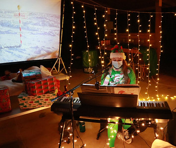 690 -- The Junior Women's Club of Butler held their Polar Express Christmas event in Alameda Park on Saturday night. Sarah Bishop of Butler plays the piano at one of the stations.