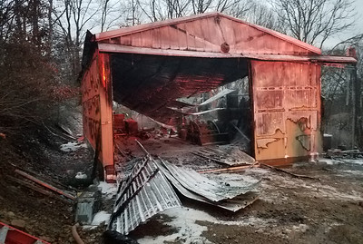 """Local fire departments contained a fire to a garage located at the end of Grandview Avenue off Hill Street Monday evening in Evans City. A neighboring house did not sustain any major damage. No injuries were reported at the scene.""Photo by Samantha Beal."