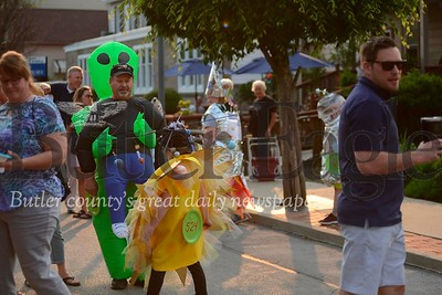 Len Karch, left, is pictured here dressed as a human being carried by an alien from outer space at the Mars New year celebration Friday.