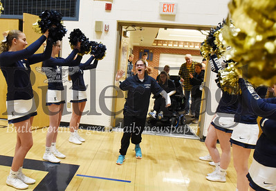 Harold Aughton/Butler Eagle: Surrounded by cheerleaders and a roaring crowd, Natalie Gall enters the Knoch High School gymnasium for the school's first bocce tournament against Butler.