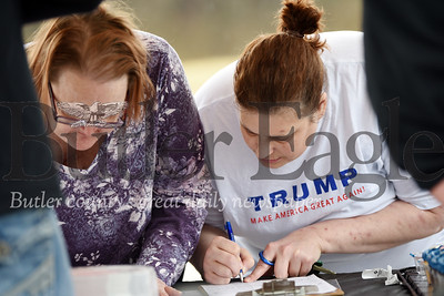 Harold Aughton/Butler Eagle: Roomates Kathy Weterman and Kris West of Butler sign the Trump for president petitions Tuesday, February 4, 2020.