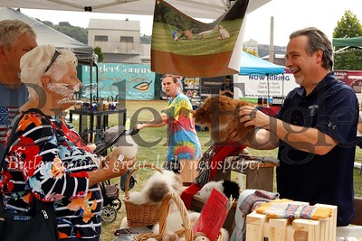 Gary Zacherl of Stone's Throw Farm shows off an alpacca wool stuffed animal at Butler Fall Fest. Seb Foltz/Butler Eagle