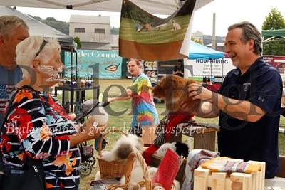 Gary Zacherl of Stone's Throw Farm shows off an alpacca wool stuffed animal at Butler Fall Fest. Seb Foltz/Butler Eagle