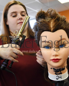 Harold Aughton/Butler Eagle: Brianna Wells practices her curling techniques during a recent hair styling class at the Butler County Vo-tech.