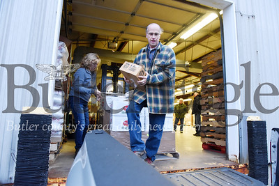 Harold Aughton/Butler Eagle: Volunteer Tom Rea of Chicora picks up food to be taken to the Petroia Food Cupboard.