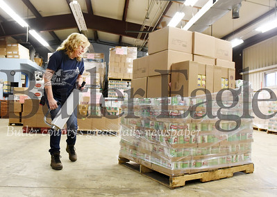 Harold Aughton/Butler Eagle: Sue Leinbnbach, a credentialing specialist for the Alliance for Non-profit Resources, prepares a pallet of food for distribution.