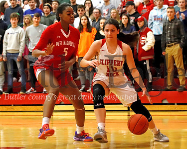 Slippery Rock's Ella McDermott drives to the hoop against West Middlesex's Makennah White. The Rockets fought back from a more than 10 point deficit to top West Middlesex 55-51. Seb Foltz/Butler Eagle