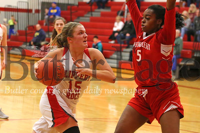 Slippery Rock's Bronwyn McCoy (15) drives the lane against West Middlesex's Makennah White. The Rockets overcame a more than 10 point deficit to top West Middlesex 55-51. Seb Foltz/Butler Eagle