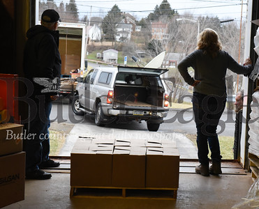 Harold Aughton/Butler Eagle: Don Wallace of Slippery Rock, and Sue Leinbnbach of the Alliance for Nonprofit Resources Run Distribution, wait to load another truck of food to be distributed to one of the ? food banks in Butler County.