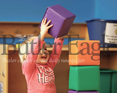 Corbin Bargo, 2, of Meridian builds a tower out of blocks in the kids space at the Butler Area Public Library Wednesday. Seb Foltz/Butler Eagle