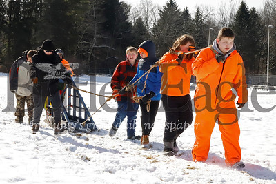 Members of Lyndora-based Boy Scout Troop 20 compete in the sled pulling competition in the annual Boy Scout Klondike Derby at Camp Buccoco Saturday near Slippery Rock. 02/15/20 Seb Foltz/Butler Eagle