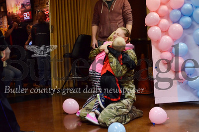 U.S. Army Staff Sgt. Brittni Krill embraces her children Julianna and Brantley. Krill surprised her children and husband, John Krill, Saturday with an unexpected appearance at a party at Butler's American Legion Post 117. Tanner Cole/Butler Eagle