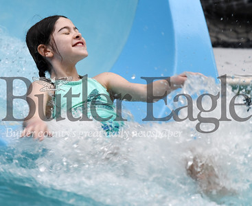 Harold Aughton/Butler Eagle: Hanna Wright, 10, of Butler slides into the pool at Conley Resort's Pirate Cove during the Autism Society swim event Monday, February 17, 2020.