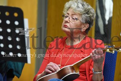 Harold Aughton/Butler Eagle: Joanne Merlder of Cranberry strums her ukulele as part of the Dutilh United Methodist Church music ministry Thursday, February 13, 2020.