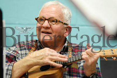 Harold Aughton/Butler Eagle: Clyde Cameron of Cranberry follows along with his ukulele during a recent lesson at the Dutilh United Methodist Church.