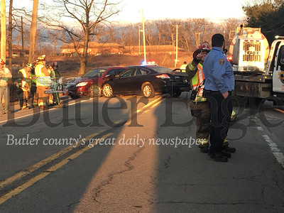 Cement Truck Accident  Cutline: One person was injured after a vehicle reportedly turned in front of a cement truck in an attempt to turn on Stirling Drive in Butler Township resulting in a three vehicle accident on Thursday Feb. 20, 2020. Photo by Lauryn Halahurich/Butler Eagle