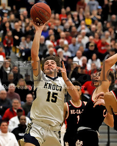 Knoch's Jared Schrecengost extends for a layup in Saturday's WPIAL playoff against New Castle. The Knights fell to New Castle  56-55 at North Allegheny. Seb Foltz/Butler Eagle