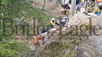 Photo by Jim SmithVolunteer firefighters rescue a 21-year-old woman who fell about 80 feet down a cliff Sunday afternoon at McConnells Mill State Park in Slippery Rock Township, Lawrence County. The woman, a student at Slippery Rock University, suffered a number of injuries but non believed to be life threatening. She was flown to a Pittsburgh hospital by medical helicopter.