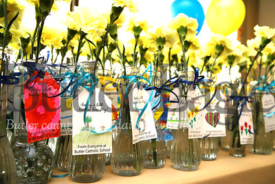 Donated flowers, leftover form Butler Catholic School's Purse Bash Fundraiser,  await residents at Sunnyview Nursing and Rehabilitation Center. Students from Butler Catholic made cards and helped deliver the left over flowers Saturday following the previous night's fundraiser. Seb Foltz/Butler Eagle
