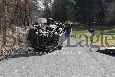 A pickup in its final resting place after flipping over Monday morning on Reamer Road. The driver was the sole occupant and he was uninjured.