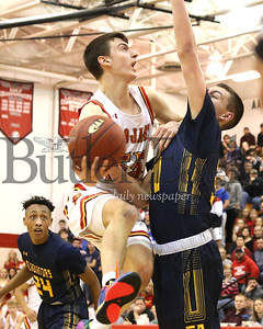 North Catholic's Isaac DeGregorio (55) fights for a shot over South Allegheny's Ayden Sloss in Monday night's WPIAL playoff in at North Hills. Seb Foltz/Butler Eagle