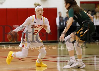 North Catholic's Emma Pospisil fakes left to drive the lane against Blackhawk's Quinn Borroni (4) in Monday night's WPIAL playoff win at North Hills. Seb Foltz/Butler Eagle