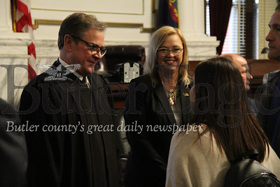 Newly elected Judge William Robinson, left, and Prothonotary Kelly Ferrari speaking with members of the public during Friday's swearing in ceremony for newly elected county officials.Photos by Eric Jankiewicz