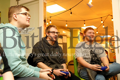 Ryan Kish (left), Stephen Matousek and Aaron Bennett compete in a round of Smash Brothers at Parents in Toto's community center game day Saturday. The Zelienople-based non-profit offers a community center and resources for teens and young adults with Autism and their families. Seb Foltz/Butler