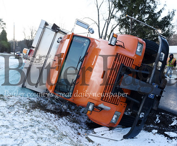 Harold Aughton/Butler Eagle: A Jefferson Twp. municipality truck flipped on its side while salting the road Wednesday, January 8, 2020.