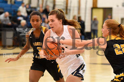 Butler's  Jordan Kaufman #15 drives to the hoop past North Allegheny's Emma Fischer20 (right) and Jasmine Timmerson #3 during Thursday night's game. Seb Foltz/Butler Eagle