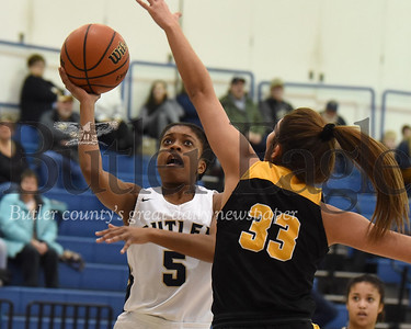 Butler's Sarayne Forbes #5 gets a shot off over North Allegheny's Kat Balouris #33 during Thursday night's home game at Butler. Seb Foltz/Butler Eagle